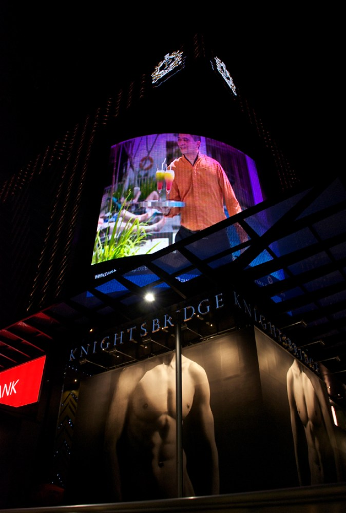 The huge advertisements in wall LEDs; Below- American fashion retailer Abercrombie & Fitch's advertisement - It opened a flagship store on Orchard Road on December 15, 2011. The store was marked by tremendous controversy over this ad during its construction phase!