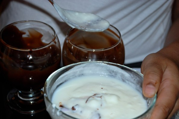 Pouring the yoghurt into the chocolatey sundae bowl
