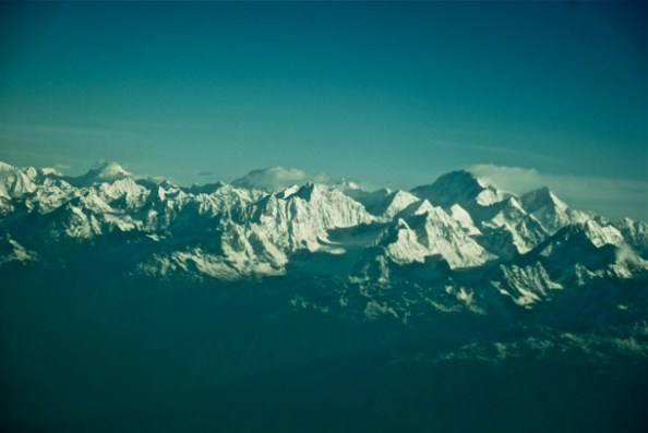 The numerous peaks and summits of the Himalaya, bathed in the warm rays of the morning sun