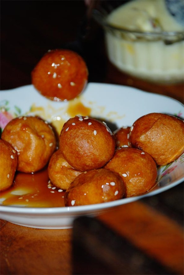 Leqaimat/Golden fried dough balls coated with date syrup
