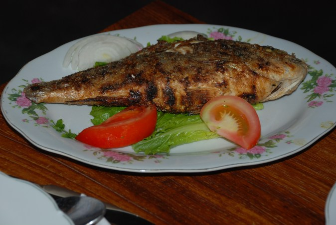Samak Mashwi – Samak or Fish grilled (Mashwi) with special Arabic spices and served with white Rice.