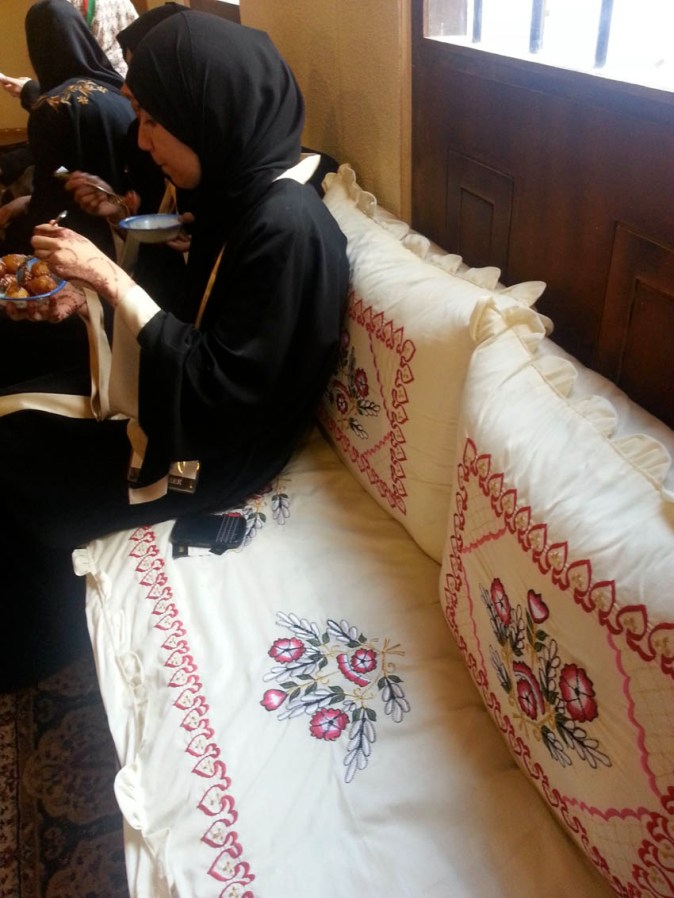 Traditional embroidery adorning the pillows and the cushions inside the Majlis