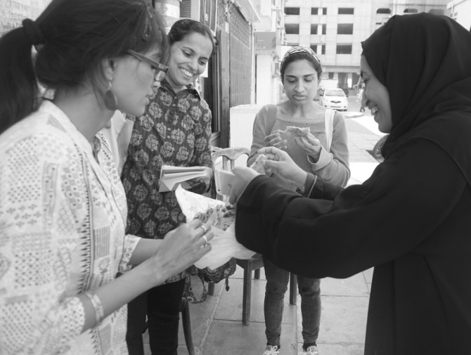Arva shares the 'unshareable' tandoori naans with Sangeetha Swaroop (of Gulf News), Afsha Hamed (of The National) and Fatima Al Suwaihi (right)