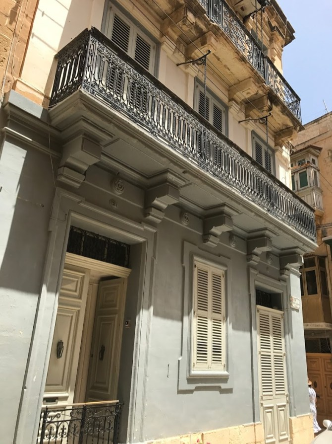 Filigreed verandas of traditional buildings in Birgu