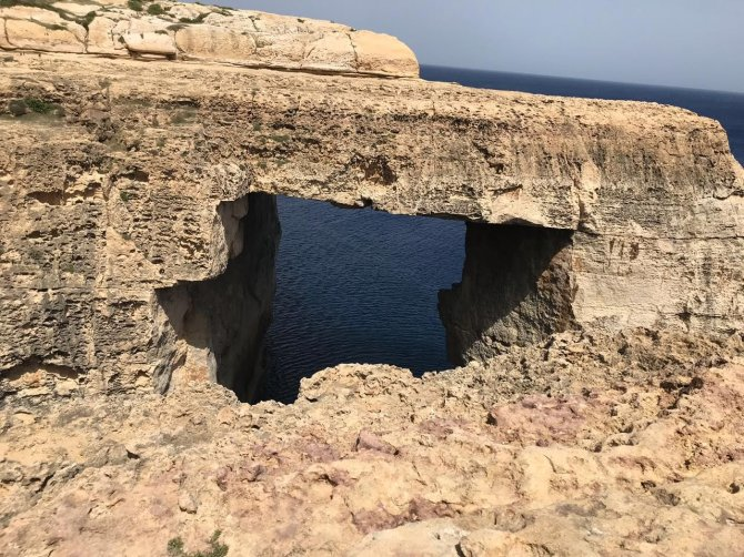 The Wied il-Mielaħ Window is a limestone natural arch in Gozo