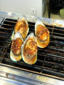 Grilled mussels in Floating Market in Global Village