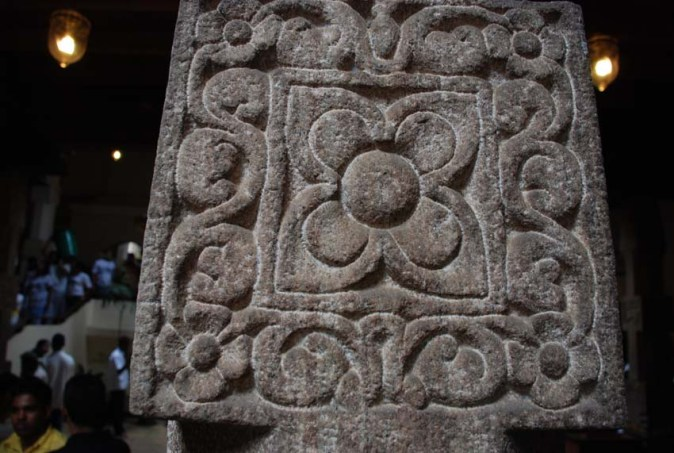 Intricate stone carvings in Kandy's Temple of the Tooth Relic