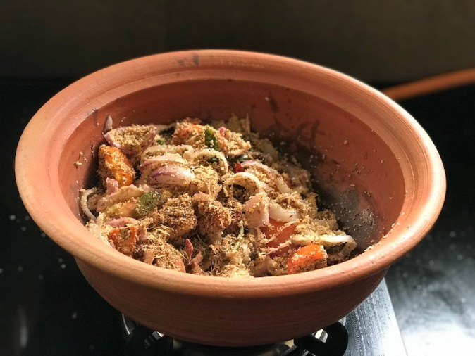 Cooking Chettinad Chicken in a claypot