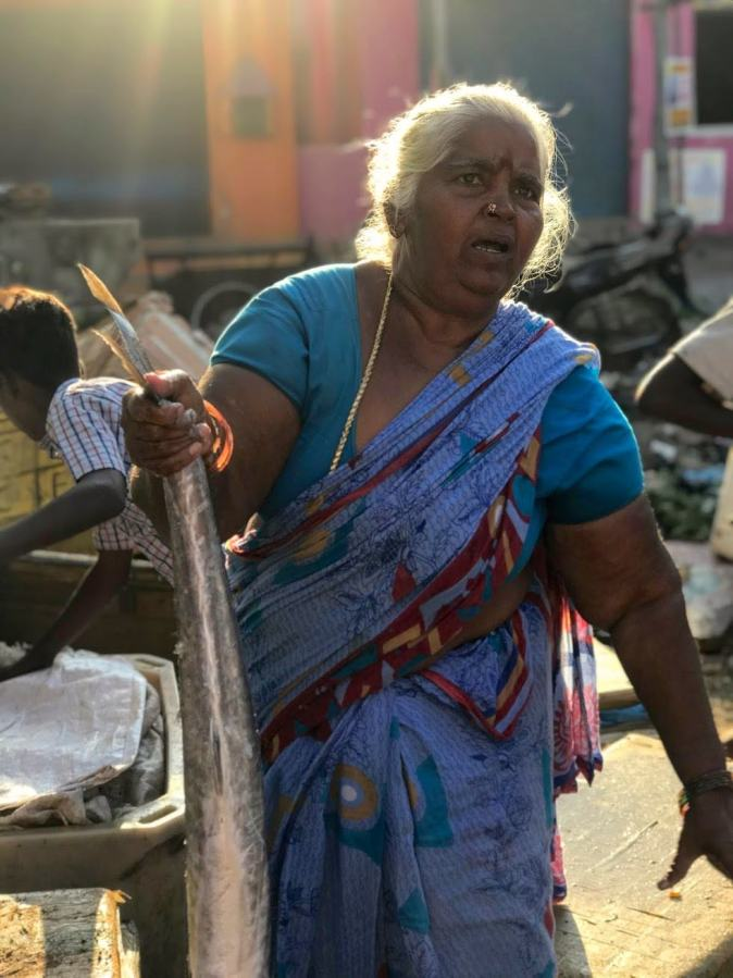 A fisherwoman in Kovalam fish market in Chennai