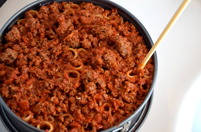 Pushing meat into pasta