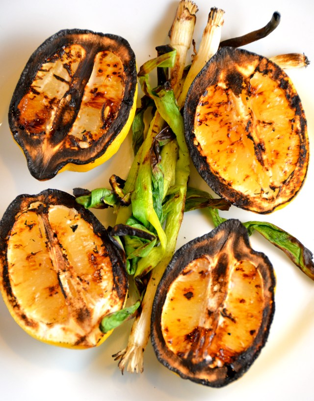 Grilled lemons and green onions