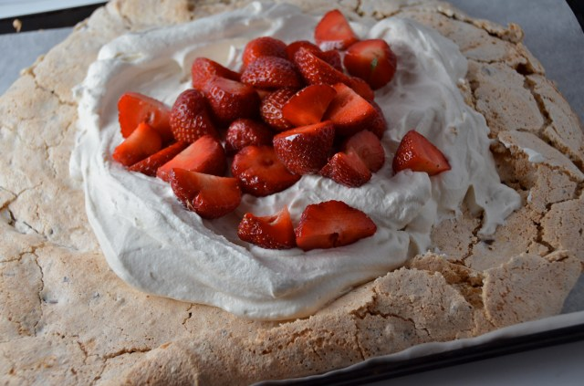 Giant Nutty Chocolate Chip Pavlova With Strawberries And Cream