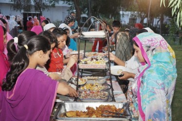 SOS Village Children enjoying the Ramadan Iftar dinner organised at SOS Children's Village in Rawalpindi.