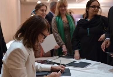 Regula Bubb- Abderhalden signs copies of her book, High-Life in Pakistan