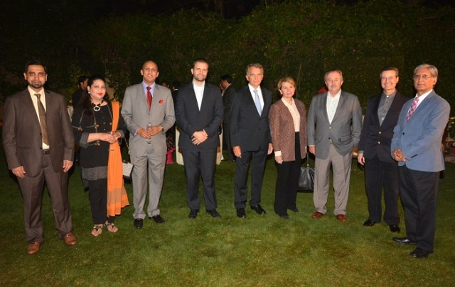 <em>Ambassador of Argentina, Rodolfo J. Martin-Saravia (third right), statesman Aitzaz Ahsan (extreme right) with other guests at the event marking 60th anniversary of Pakistan and Cuba diplomatic ties.</em>