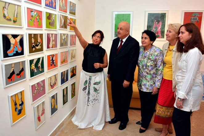 Liudmila López Domínguez (first left) showing her artworks to Cuban Ambassador, Jesús Zenén Buergo Concepción, Madame Concepción and others at the art exhibit by 30 Cuban artists in Islamabad.