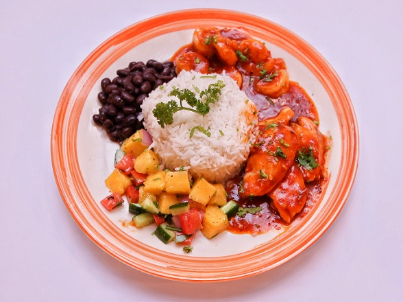 Chicken with spicy red sauce, black beans and mango salsa served with white rice at Social Cafe Islamabad