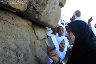 Muslim pilgrims pray on a rocky hill called the Mountain of Mercy on the Plain of Arafat near Mecca, Saudi Arabia on November 5, 2011. (Hassan Ammar/