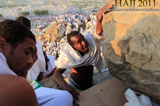 Muslim pilgrims climb a rocky hill called the Mountain of Mercy on the Plain of Arafat near Mecca, Saudi Arabia on November 5, 2011.