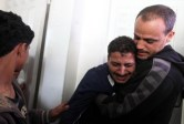 nov-21-2012-man-mourning-over-the-loss-of-a-relative-in-gaza-morgue