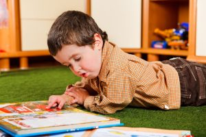 Tips for Islamic Parenting from the Hadeeth Preschool-boy-reading-book_shutterstock_52401154