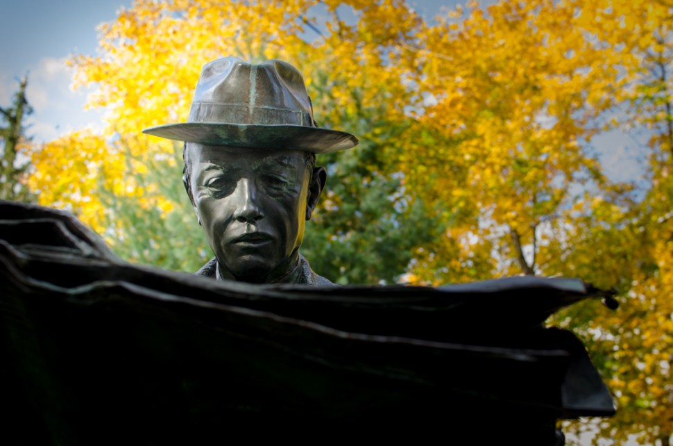 "Seward Johnson's mystery ""Newspaper Reader"" located at Princeton's Battle Monument park., read"