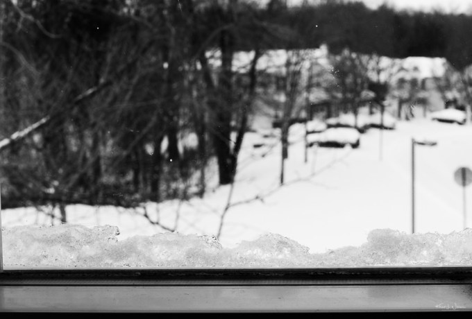 snow on the ground, view from a window
