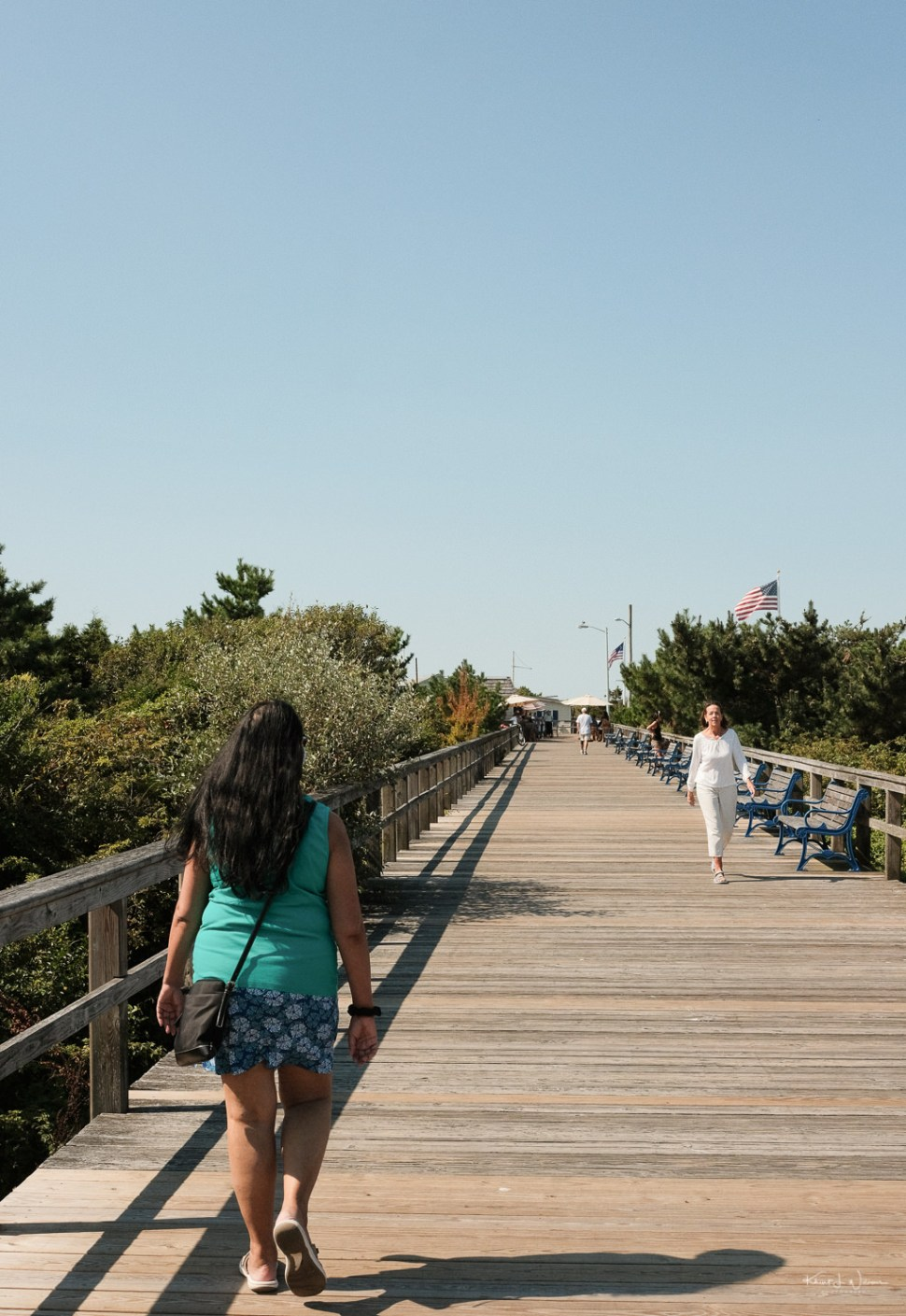 Bhavna walking on Avalon Beach Boardwalk