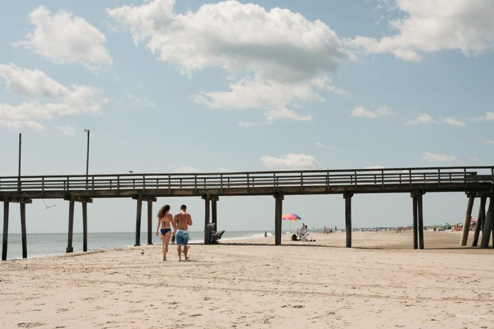 Couple walking to dock Beach Scene