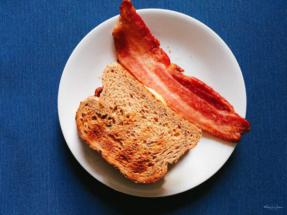 bacon and toast on plate