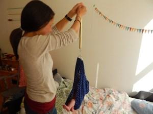Weighing baby during postpartum home visit