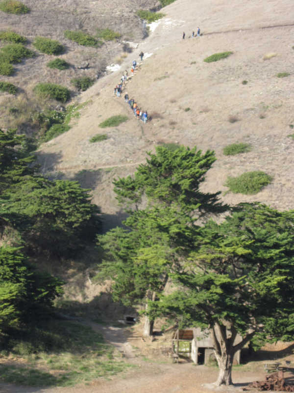 Hikers going up the Cavern Point Trail