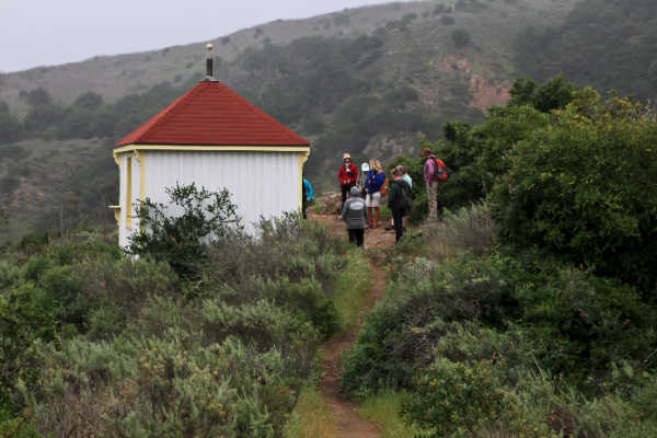 "Hikers stop at ""the lookout"" on the Pelican Trail"