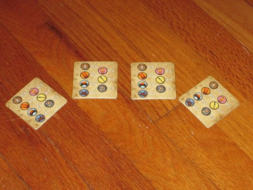Player aids help contestants remember the distribution of mobilization tokens in the bag. But there are only four, so you'll have to share if you're playing with a full six players.