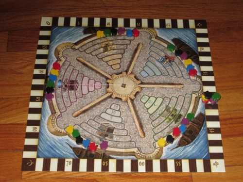 The game board for Medici. This tracks each player's points and placement on the commodity pyramids, which score at the end of each round.