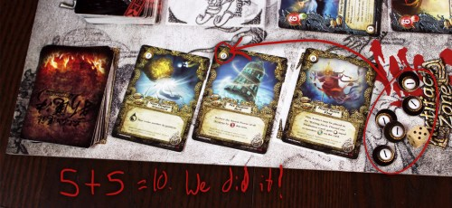 All these point tokens have a further use – alchemy. We can use Alchemy to obtain powerful Artifacts.  This doesn't technically cost us points, since we factor in the value of an Artifact for points, but we can play a little game to boost our points. We can choose to spend fewer points than we need and roll a die – if the total is enough to buy the card we want, score! Extra points! If not, we lose the points and fail to get the card. We're going to risk it.