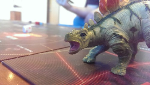 Cornok the Firefly Dinosaur welcomes you to Gen Con!