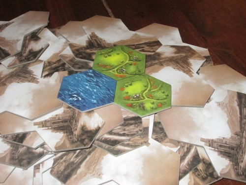 The map in Barony is made up of nine terrain tiles per player. Each tile is made up of three terrain hexes, and players can arrange the board however they want at the start of the game.