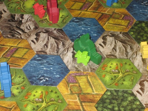 Green has a city in the mountain. This alpine fortress between two lakes prevents other players from getting through.