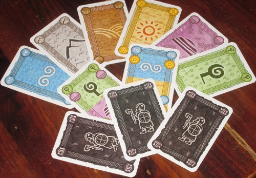 The terrain cards in Hengist, with the explorer cards at the bottom. The illustrations and coloring are gorgeous.