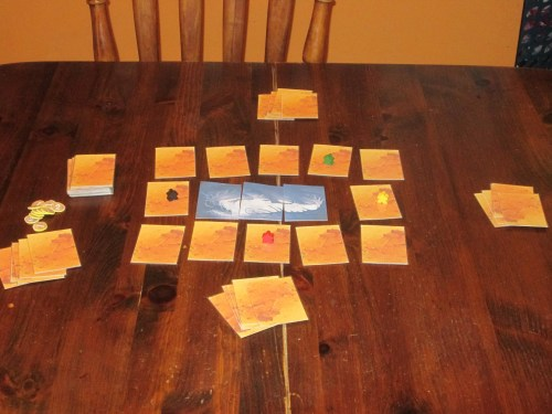The setup for a four-player game of Hoard.
