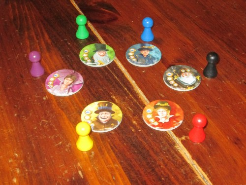 Each player claims a pawn and button noting their quirky adventurer.
