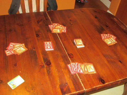 Farmageddon set up for four players. Setup is simple: shuffle two decks of cards and place them on the table.