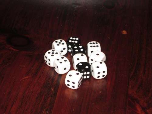 The dice pool for a four-player game. The black dice are plague dice and carry a penalty of 2 time if they are chosen.