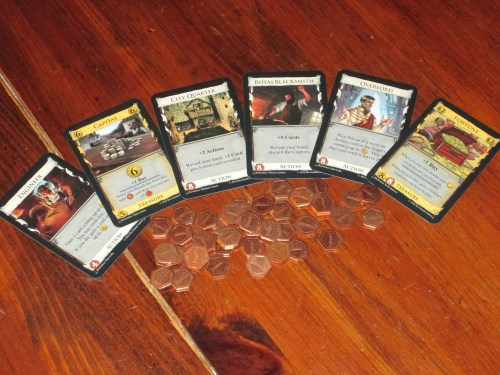 I love the debt concept, and the included metal debt tokens are a good way to track it.