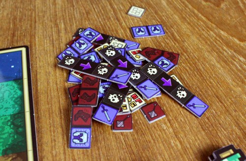 a pile of Rune tokens featuring upgrade icons for player characters