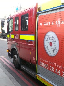 Firefighters prepare to leave outside Clerkenwell fire station. Image: Eleanor Busby