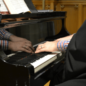 Hands playing piano image
