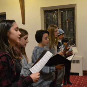 Youth singing in a choir at Islington United
