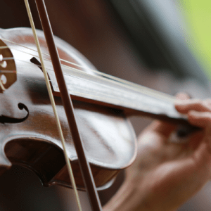 Close up image of a person playing the violin